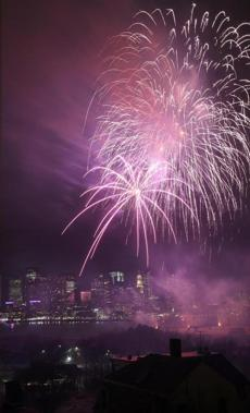 Fireworks rose over the Boston Harbor during the First Night celebration.