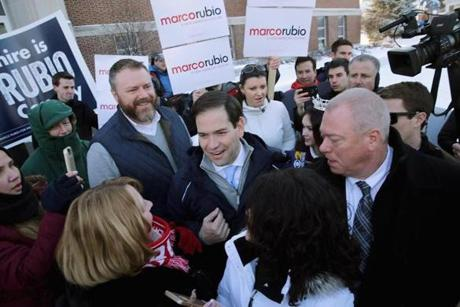 Republican presidential candidate Sen. Marco Rubio thanked supporters outside the polling place at Webster School in Manchester, N.H.