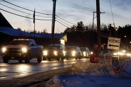 Voters waited in a miles long line of traffic to vote in the New Hampshire primary in Merrimack, N.H.