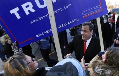 Republican presidential candidate New Jersey Gov. Chris Christie shook hands with supporters of Donald Trump while visiting a polling station in Londonderry, N.H.