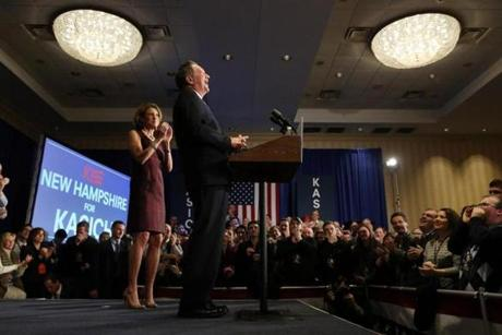 Republican presidential candidate Ohio Gov. John Kasich addressed supporters with his wife Karen during a primary election night party at the Grappone Conference Center in Concord, N.H.