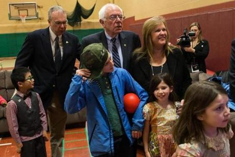 Democratic presidential candidate Bernie Sanders and his wife, Jane O'Meara, watched early results with extended family and friends in Concord, N.H.
