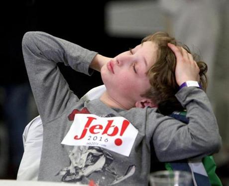 Theodore Kraemer, 8, of Bedford, N.H., seemed to have trouble staying awake at Jeb Bush's primary election night party at Manchester Community College in Manchester, NH. February 9, 2016.
