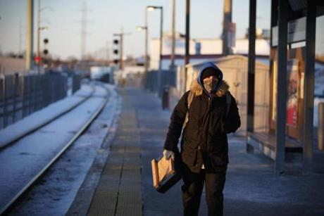 At the Beverly Depot commuter rail station, Jason Burroughs of Gloucester waited in the frigid temperatures for an MBTA train with everything but his eyes covered up.