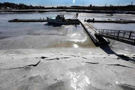 The fishing boat Mildred was frozen to the dock in Scituate Harbor early Sunday morning as the temperature on the coast was minus 2 degrees.
