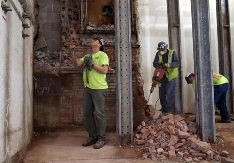 Boston, MA - 2/16/2016 - Workers demolish a wall inside the Boston Public Library in Boston, MA February 16, 2016. Jessica Rinaldi/Globe Staff Topic: 22BPLrenovations Reporter:
