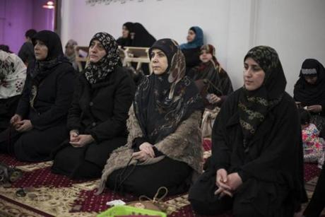 Women listened as Imam Hassan Qazwini spoke during a recent service.