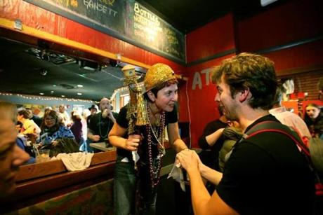 Owner Carla DeLellis shook hands with Greg Jukes, a percussionist who thanked her for providing a venue for musicians.
