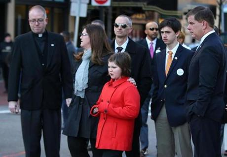 The family of Martin Richard, the youngest victim of the 2013 Boston Marathon bombings, attended a wreath-laying ceremony Friday with Mayor Martin Walsh (right).