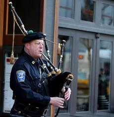 04152016 Boston Ma Boston Police Seargent/Detective Tim Horan (cq) warms up before Wreath Laying ceremonies on Boylston Street to honor Marathon Bombing victims. .Boston Globe/Staff Photographer Jonathan Wiggs