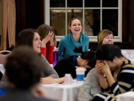 Asya Troychansky, 30, laughs during a salary negotiation exercise at a workshop offered by the city of Boston at the YWCA.