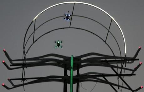 Two drones race during the final day of the first World Drone Prix in Dubai, United Arab Emirates, Saturday, March 12, 2016. (AP Photo/Kamran Jebreili)
