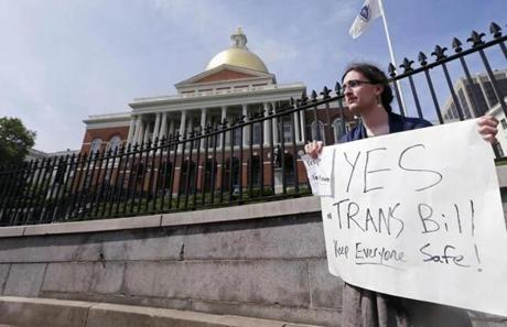 Asa Goodwillie of Watertown, Mass., who is transgender, protested outside the State House in Boston.