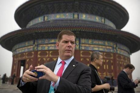 Boston Mayor Marty Walsh takes a smartphone photo at the Temple of Heaven in Beijing, Wednesday, June 8, 2016. Walsh is part of a delegation of leaders from American cities participating in the U.S.-China Climate-Smart/Low-Carbon Cities Summit. (AP Photo/Mark Schiefelbein)