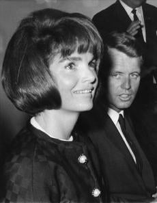 Mrs. Jacqueline Kennedy, wife of the late president, John F. Kennedy, talks to newsmen in New York, United States on May 25, 1964 during a preview tour of the exhibit of the late President Kennedy's mementoes. At her side is U.S. Attorney General Robert Kennedy, brother of J. F. Kennedy. (AP Photo) -- 071016rfkexcerptV2