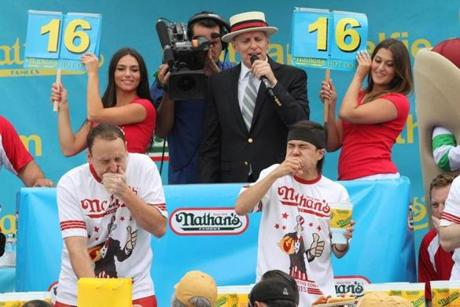 Matt Stonie (right) competed against Joey Chestnut (left) in the 2015 hot dog contest.