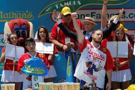 Joey Chestnut (right) celebrated winning Nathan's Famous Fourth of July International Hot Dog-Eating Contest ahead of Matt Stonie (left) at Coney Island in 2016.