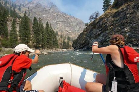 Mason Roberson and his grandmother Margaret Gorcyca digged in for the next rapid on the Middle Fork.