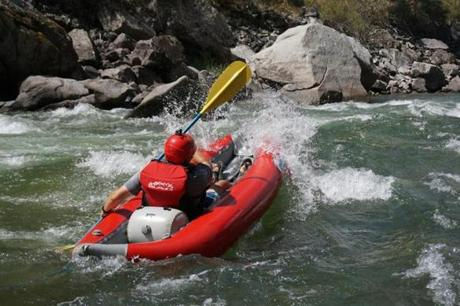 The author, David Goodman, surfs a wave on the Middle Fork.