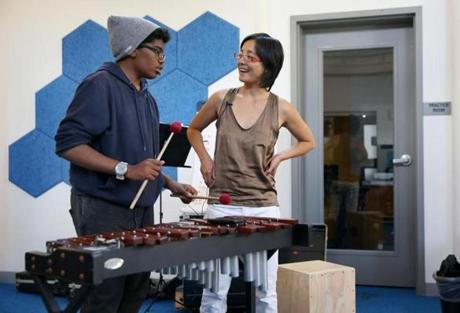 Shaw Pong Liu, one of Boston's artists-in-residence, with Robert Green, 14, of Dorchester during a Code Listen musical session.