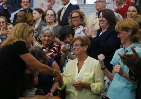 Lieutenant Governor Karyn Polito shook hands with Dorothy Simonelli Monday at the State House.