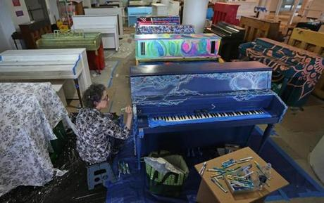 Artist Claudia Ravaschiere of Boston worked on one of the pianos that will be installed in public spaces around Boston.