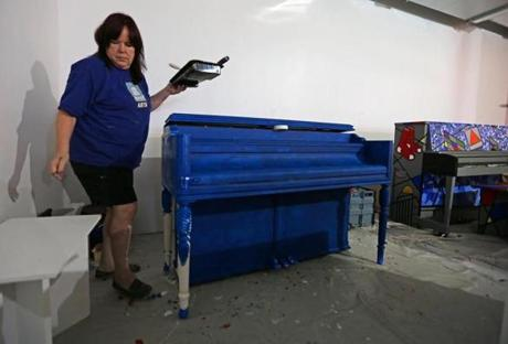 Artist Dawn Evans Scaltreto of Watertown worked on her piano project.