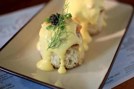 Uni Benedict toasts with sunny-side-up quail eggs and hollandaise.
