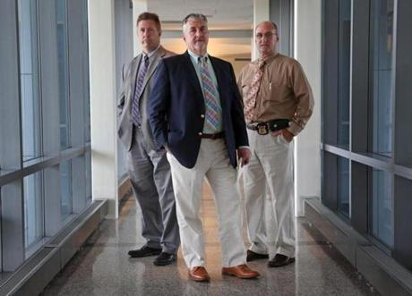 Members of the unit unit include Doogan (center) and Detectives Kevin Pumphret (left) and John Cronin.