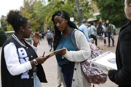 Oluseun Omitoogun (left) of NextGen Climate tried to persuade Mahogany Monette to commit to vote at a University of North Carolina at Chapel Hill event.