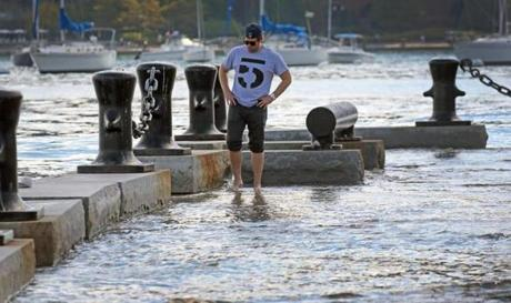 Andrew Dzurovcik was visiting Boston from Chicago when he spotted the high tides at Long Wharf.