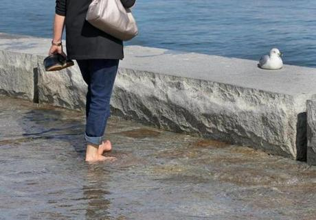 Gail Garrett, who was visiting Boston with her husband from upstate New York, waded through the water barefoot.