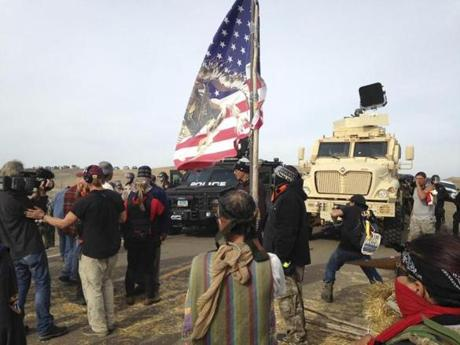 Dakota Access pipeline protesters defied law enforcement officers trying to force them from their camp.