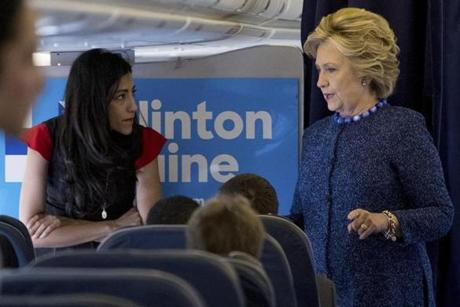 Hillary Clinton spoke with senior aide Huma Abedin on Friday aboard her campaign plane at Westchester County Airport in White Plains, N.Y.