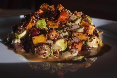 Chelsea, MA - 11/1/2016 - A vegetable salad of roasted onion, carrot, brussels sprouts, beets, butternut squash, red quinoa and a roasted pepper vinaigrette sits on a table at the Chelsea Station Restaurant Bar and Lounge in Chelsea, MA, November 1, 2016. (Keith Bedford/Globe Staff) Topic: Reporter: Stephanie Schorow