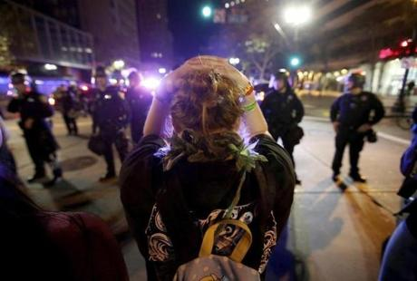A protester faced a police line in downtown Oakland, Calif.