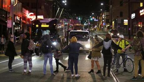 Protesters blocked traffic during a demonstration against Donald Trump in Seattle.