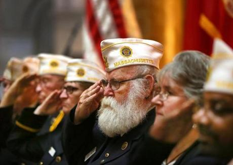 Boston-11/11/2016- Veterans salute during the posting of the colors at a Veterans Day Ceremony held at the State House in Boston. John Tlumacki/Globe Staff (metro)