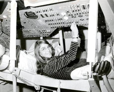 23medal Cambridge MA, 11/24/69 GUIDING HAND FOR APOLLO 12 - Margaret Hamilton of Cambridge, Mass., mathematician and computer programmer at the MIT Instrumentation Laboratory, sits in the mock-up of Apollo 12 command module on display at the Cambridge school where she headed the group that programmed Intrepid's pinpoint landing in the Sea of Storms, on the moon. AP Wirephoto