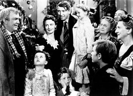"Shown: (top l to r): Thomas Mitchell, Donna Reed, James Stewart, Karolyn Grimes (ZuZu), Sarah Edwards (Mrs. Hatch), Beulah Bondi - (bottom l to r) Carol Coombs (Janie), Jimmy Hawkins (Tommy), Larry Simms (Peter) in the 1946 film ""It's a Wonderful Life,"" directed by Frank Capra. PHOTO CREDIT: Photofest 24cinemania 22tickettv"