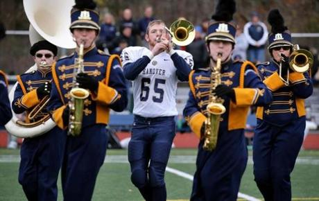 Norwell, MA - November 24, 2016: Matthew Hannigan plays the trombone with the Hanover High School Marching Band during the halftime show of the Thanksgiving day football game between Hanover and Norwell High School in Norwell, MA on November 24, 2016. When he is not playing the trombone the Senior plays defensive end with the football team. (Craig F. Walker/The Boston Globe) Section: Sports reporter: