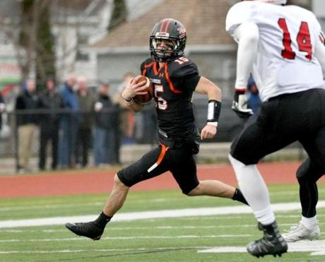 Woburn, MA: 11-24-2016: Woburn High School's no. 15 Jake Bridge during Thanksgiving Day football game against Winchester HS at Woburn HS in Woburn, MA Nov. 24, 2016. Photo/John Blanding, Boston Globe staff story/, Sports (25woburn)