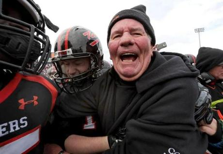 11-24-2106: Woburn, MA: Retiring Woburn High School football coach Rocky Nelson celebrates with his team after winning Thanksgiving Day game against Winchester HS at Woburn HS in Woburn, Mass. Nov. 24 2016. Photo/ John Blanding, Boston Globe staff story/ , Sports ( 25woburn )