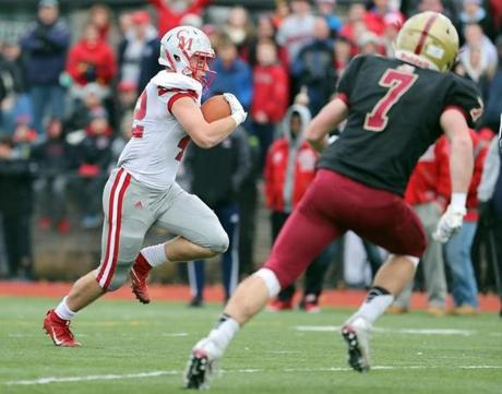 Boston MA 11/24/16 Catholic Memorial Jack McGowan scoring the game winning touchdown run beating Boston College High Kevin Ryan during fourth quarter action of their Thanksgiving Day football game at Boston College High. (Photo by Matthew J. Lee/Globe staff) topic: 25bchigh reporter: