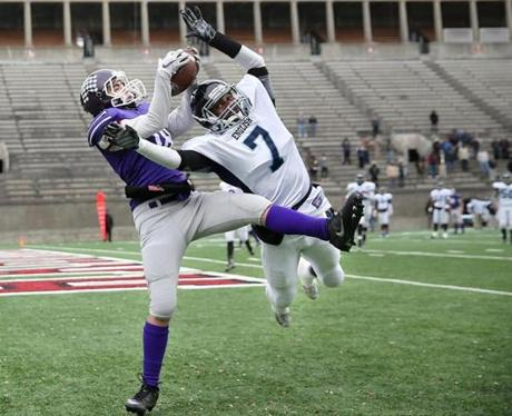 Cambridge MA 11/24/16 Boston Latin Lenny Esser making a touchdown reception beating Boston English Edner St. Fleur during second quarter action of their Thanksgiving Day football game at Harvard Stadium. (Photo by Matthew J. Lee/Globe staff) topic: 25bchigh reporter:
