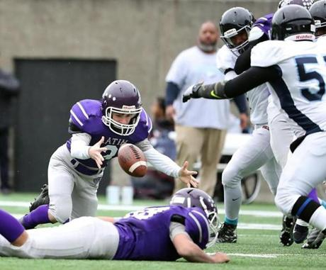 Cambridge MA 11/24/16 Boston Latin quarterback Griffin Li recovers a fumble against Boston English during first quarter action of their Thanksgiving Day football game at Harvard Stadium. (Photo by Matthew J. Lee/Globe staff) topic: 25bchigh reporter: