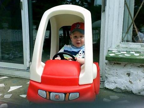 Lacey_online_Photo - Will Lacey driving a toy car. Info from source: Taken July 25, 2006. (Lacey family)