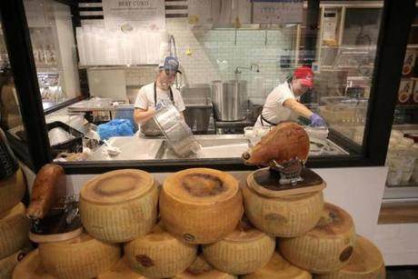 Boston, MA - 11/29/16 - Workers prepare cheese at the Mozzarella Lab at Eataly food court and grocery store in the Prudential Center. (Lane Turner/Globe Staff) Reporter: (Duggan Arnett) Topic: (live_eataly_photos)
