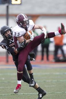 Millis-Hopedale junior defensive back Dominic Zonfrelli (23) intercepts a pass intended for Maynard tight end Jackson Dufour (87) in the third quarter of the MIAA Division 4A Super Bowl at Worcester State University in Worcester, Massachusetts on December 3, 2016. Millis-Hopedale defeated Maynard 30-18. Matthew Healey for The Boston Globe (SPORTS - Assigning Editor: Joanne Strohmeyer - Story Editor: Craig Larson)