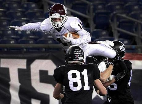 Foxborough, MA - 12/03/2016 - Falmouth Clippers Samuel Koss tries to go up and over the Marblehead defenders on a second half carry. MIAA Super Bowls: Division 2A Falmouth vs. Marblehead at Gillette Stadium in Foxborough. - (Barry Chin/Globe Staff), Section: Sports, Reporter: Karl Capen, Topic: 04HS Super Bowls, LOID: 8.3.862095835.